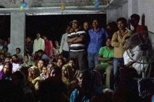 village in India watching an awareness film about human trafficking