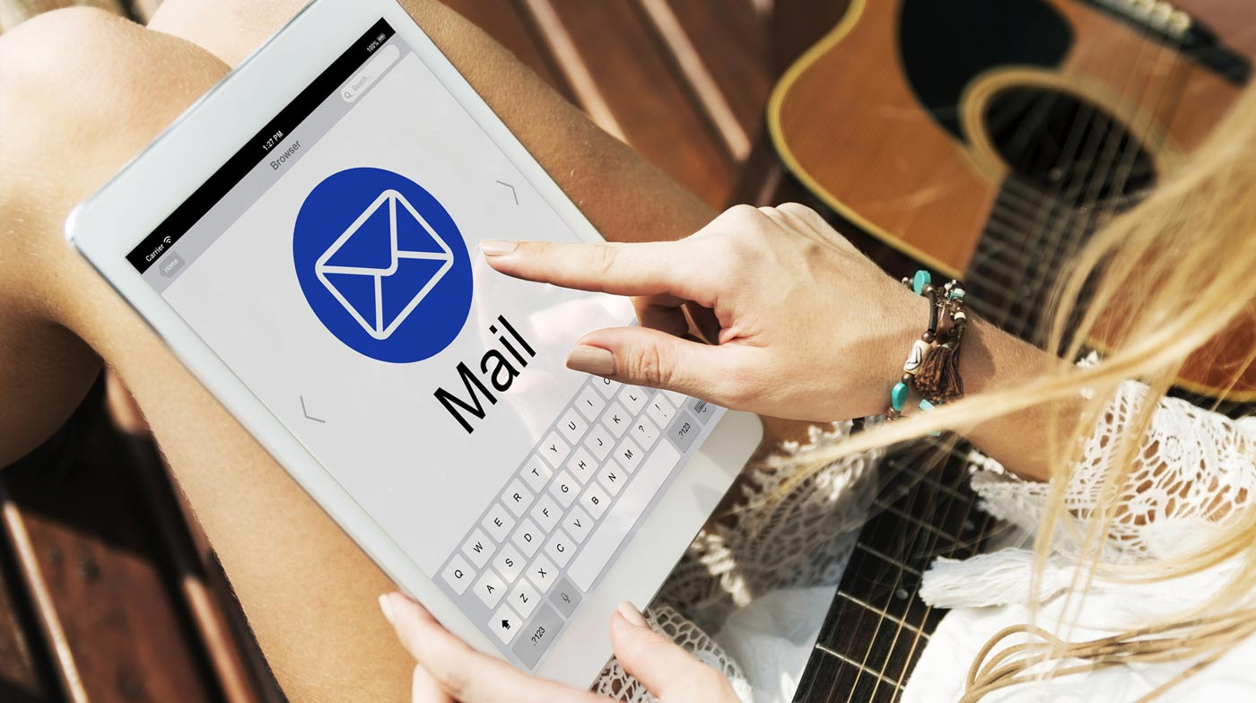 woman-looking-at-email-marketing-trends-on-tablet